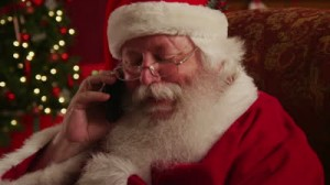 stock-footage-santa-claus-talks-on-cell-phone